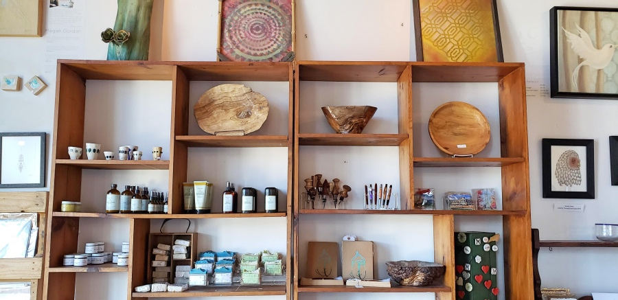 soaps and handmade bowls on display