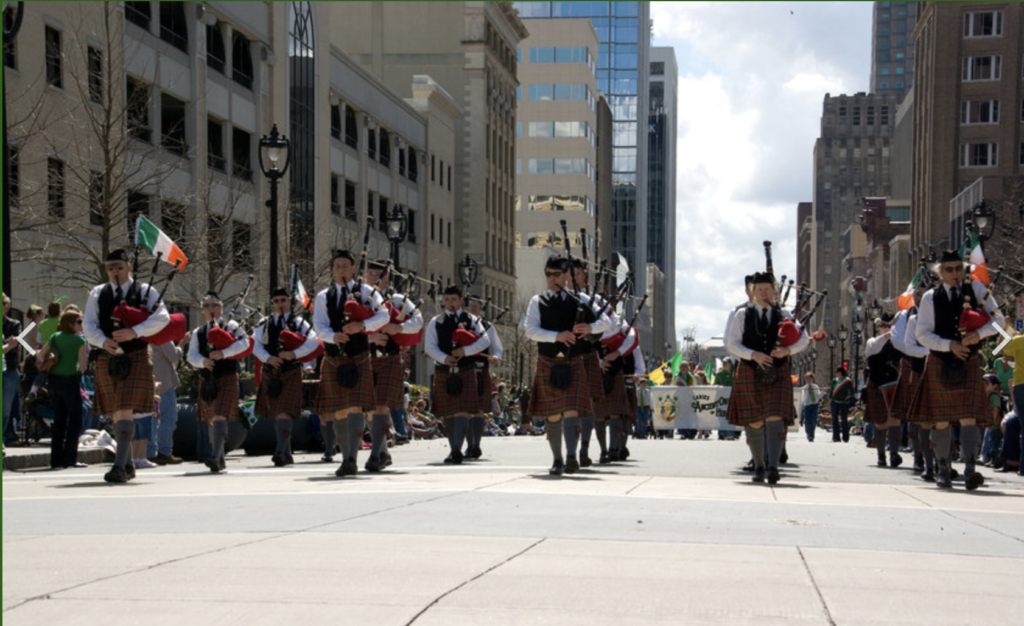 Bagpipe players downtown parade